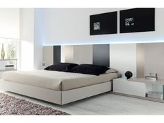 Dormitorio elegante de diseño moderno. Cabezal stripes