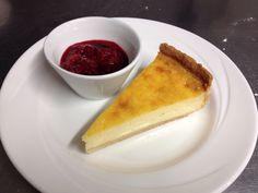 Custard tart with sweetened raspberries