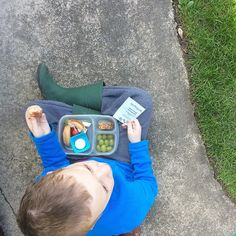 Apparently this one was a little too distracted at school to eat much, so he is sitting out in the sunshine finishing his lunch after school. #easylunchboxes