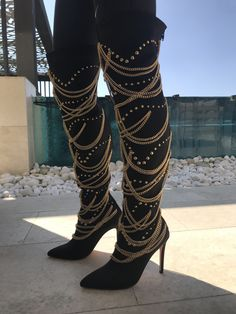 Neoprene upper with man made sole and metallic gold accents These sexy thigh high boots are embellished with metallic gold chain and stud accents for a lavish look. Thigh High Boots, High Heel Boots, Heeled Boots, High Heels, Shoes Heels, High Socks, Fashion Boots, Sneakers Fashion, Latex Fashion
