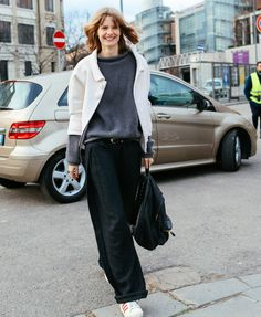Julia Stegner in a Balenciaga jacket, Christopher Kane sweater, Ohne Titel pants, and  Adidas sneakers