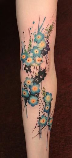Tiny Blue Flowers arm tattoo