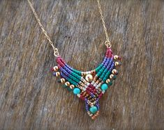 macrame necklace, tribal pendant with tassel, boho necklace, purple and gold, makrame necklace, turquoise pendant, macrame pendant, ethnic tassel, long necklace, colorful necklace    This lucky charm is hand woven from highest quality waxed cord, using the ancient technique of micro macrame. This necklace is tribal and Lusciously feminine, with a majestic allure, adding a boho touch to any look.  I weave it from the highest quality waxed cord, with muiki beads, howlite turquoise center bead…