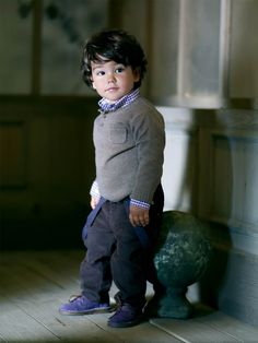 Childrens kid style: boys winter outfit - shirt sweater knit and corduroy pants.