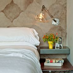 Double your bedside space with a floating shelf above your nightstand