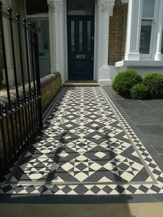 garden-blog Black, white and grey, a traditional design mosaic with diamond border and two lines.