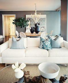 This modern living room has an elegant beach vibe.