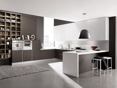 Design linear kitchen with peninsula CITY | Kitchen with integrated handles by FEBAL | design Alfredo Zengiaro