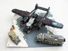 Military models built from LEGO always seem very powerful to me. This LEGO WWII aircraft is no exception. Excellent support vehicles, too. Lego Ww2, Lego Army, Lego Military, Lego Helicopter, Lego Plane, Cool Lego, Cool Toys, Awesome Lego, Wicks Diy