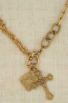 Brushed gold necklace with vintage pendant and vintage cross handmade in USA by ExVoto Vintage jewelry.  www.exvotovintage.com
