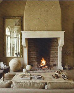 Brick and marble together up the elegance ante around this fireplace
