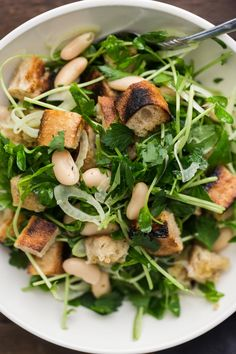 A perfect companion for grilling out, this white bean salad packs flavor with parsley, fennel, and grilled bread in place of croutons.