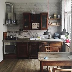 Painted brick walls is always a good idea for a back drop, or as we say in kitchen talk, backsplash. Incredible mix of design elements used here. Image via rustucstyle.tumblr.