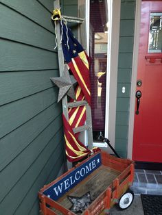 My porch is ready for Labor Day! Tied my flag with twine to a ladder behind my cute little wagon. All I need are some new flowers. (Can you find my little Boston Terrier?)