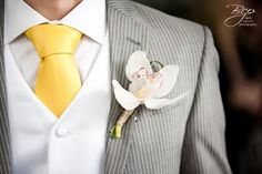 Orchid for the groom. View more tips & ideas on our Facebook Page : https://www.facebook.com/BoutiqueBridalParty