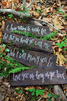 poetry on wood slats, photo by Arina B Photography http://ruffledblog.com/greenery-filled-wedding-ideas #wedding #signs #signage