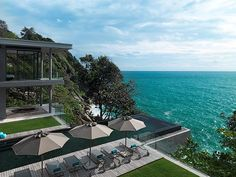 Built into the granite rock face, Amanzi features panoramic views of the Andaman Sea, an open-plan living area that stretches from the garden entrance to to the infinity pool, and even it's own mountain stream. This is where modern design meets natural beauty.