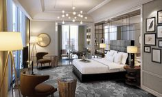 Langham Hospitality Group-- Modern gray interior with gold accents soften with organic elements (seats, carpet, warm lamp shades, nature art)