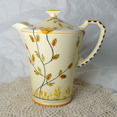 Art Deco Crown Devon Fieldings Coffee Pot or Tall Teapot Creamy Yellow with Hand Painted Autumn Pattern Made in England 1930s by Wicksteads on Etsy https://www.etsy.com/listing/240123559/art-deco-crown-devon-fieldings-coffee #coffeeartpainting