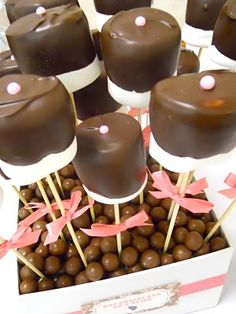 marshmallow covered in chocolate... add a bow for a minnie mouse themed party!