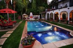 Design ideas for a mid-sized mediterranean backyard custom-shaped lap pool in Los Angeles with a water feature and concrete slab. Description from houzz.com. I searched for this on bing.com/images