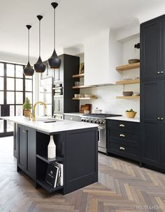 Wood herringbone kitchen floors contrast with stunning aesthetic against black kitchen cabinets, doors, and shelves. Black Kitchen Cabinets, Kitchen Cabinet Design, Black Kitchens, Interior Design Kitchen, Home Kitchens, Kitchen Designs, Green Cabinets, Kitchen Armoire, Timber Kitchen
