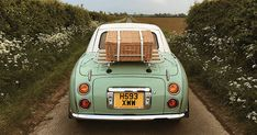 These Pictures Are Worth a Thousand Trips Nissan Figaro, Figaro Car, Wes Anderson Book, Retro Cars, Vintage Cars, Budapest, South Yorkshire, Yorkshire England, Vogue Mexico