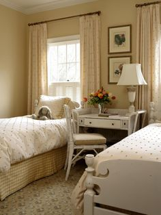The polka-dotted bedding and matching curtains draw the eye up, opening the middle of the room. A plaid dust ruffle and brown floral carpet complement the white vintage desk for a harmonious blend of shabby chic style.