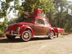 Vintage VW beetle complete with single wheel trailer.