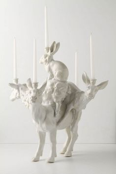 Glue plastic animals to each other, add candle holders, spraypaint...and bam! haha!