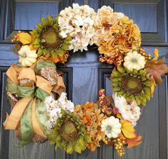 I bought one of @ideasbloom #holiday #wreaths for spring. And I just love this #autumn #decoration for the front door. Can't wait to see what she has coming out for #Christmas