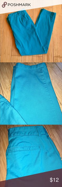 Caribbean Blue New York & Company Crop Pants Bright Caribbean blue crop/ankle pants. I'm 5'1 and they fit me like regular length pants. Cotton blend and comfy! Gently used and in great condition. Has front pockets but not back pockets, just designed to look that way. Size is 0 but I also wear 1 and 2 size pants and these can fit a little larger too in my opinion. Worn only once! New York & Company Pants Ankle & Cropped