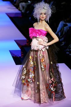 Christian Lacroix Spring 2003 Couture. Take out the light pink oven mitt looking thing and we're good