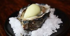 Ostra: Freshly shucked oyster with Cucumber sorbet.