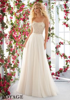 Wedding Dresses By Voyage featuring Full Flowing Soft Net Skirt Skirt with Satin Waistband and Zipper Back. Shown with bodice 6820 (Style 68206822 as pictured). Available in White, Ivory, Ivory/Light Gold.