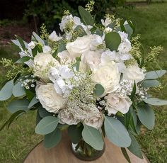 With roses, stock, spray roses, queen anne's lace, baby's breath and eucalyptus greenery.