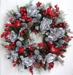 Christmas Wreath ,Holiday,Winter,Red Robins, Silver Pine Cone, Holly Berries Flower Door Wreath. $79.95, via Etsy.