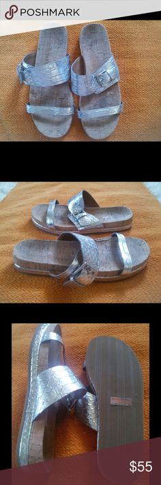 Coach sunny sandals I'm selling a coach sunny snake embossed leather and cork comfort slide sandal shoe silver, peeling at cork as seen in the photos, but nothing major sandals are in very good condition. Size 7.5 Coach Shoes Sandals