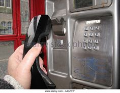 picking-up-the-handset-in-a-public-telephone-box-uk-a4apfp.jpg (640×500)