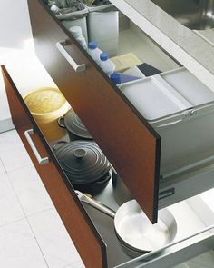 Small pots and pans could be stored in a spacious drawer.