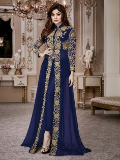 Mystical blue partywear high slit style suit online which is crafted from georgette fabric with exclusive zari embroidery and stone work.