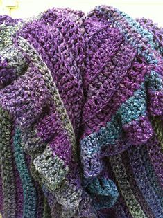 A large hook and self striping yarn make this a quick project to crochet!