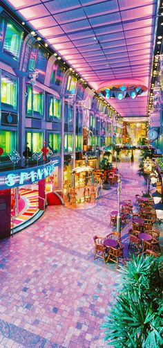 Stroll down Main Street while onboard Voyager of the Seas. The Royal Promenade features bars, shops, a casino, and nightly entertainment.