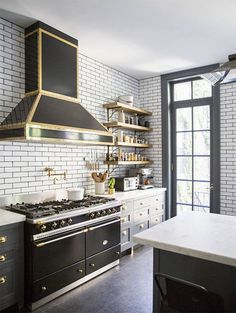 The Glamorous Look of a Black and Gold Kitchen | HomeandEventStyling.com