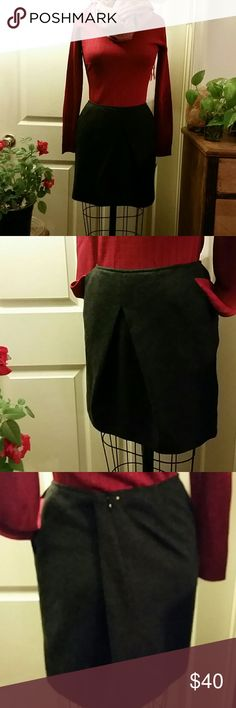 "CAbi Flannel Charcoal Size 6 Skirt Front middle inverted pleat, front curved pockets, back invisible zip, 16"" waist which is probably meant to be worn below waist, hip 20"", length 17"", NWT Please note: I think this runs large, like an 8, but you judge with the measurements. Ty! CAbi Skirts Mini"