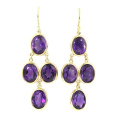 Amethyst Gold Drop Earrings. These beautiful earrings are made with 18KT yellow gold and 4 oval amethyst weighing approximately 14.00 Cts.  c 2014