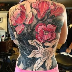 Black, Pink and White Magnolia Tattoo for Full Back. Get your back covered with something meaningful and extravagant. You can add more colors to this tattoo or just go with the one as in the picture.