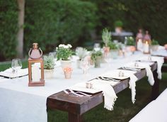 Create a garden-inspired tablescape by incorporating small potted plants, candlelit lanterns, and relaxed place settings into your rehearsal dinner décor. #rehearsaldinner #rustic #tablescape Photography: Jessica Claire Photography. Read More: http://www.insideweddings.com/weddings/an-intimate-alfresco-rehearsal-dinner-in-california/485/