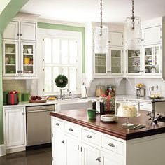 Decorate with Green | A Splash of Green | SouthernLiving.com    Farm house sink, wood island topper, white cabinets!!  Oh my!!