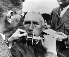 A Jewish man having his nose measured during Aryan race determination tests in Nazi Germany, 1940